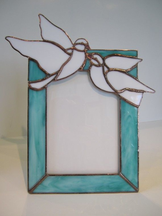 """Dove Picture Frame by GriffithDesigns on Etsy  This wonderful picture frame is a perfect wedding present.   Nothing says LOVE like a pair of white doves.   This frame holds a standard 5 X 7 photograph   and measures 11 3/4"""" by 10"""""""