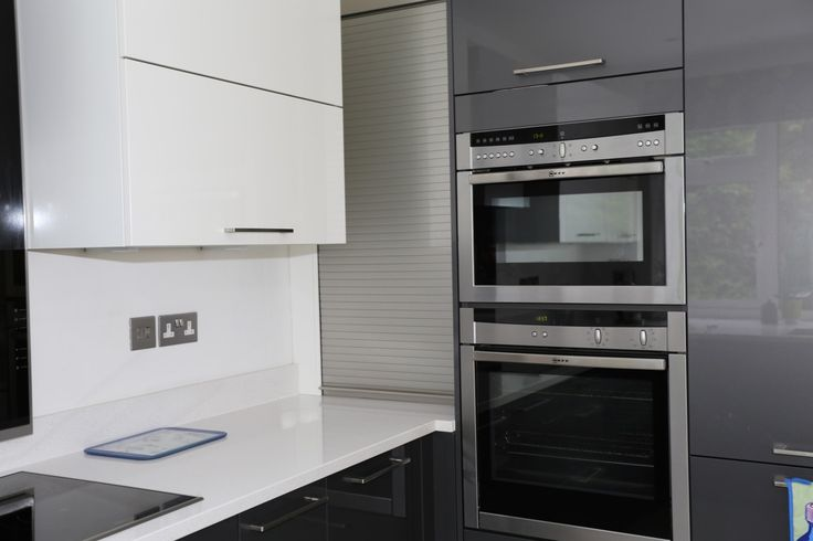 Shiny Magnolia/cream and anthracite/grey kitchen Neff Oven and microwave with roller shutter