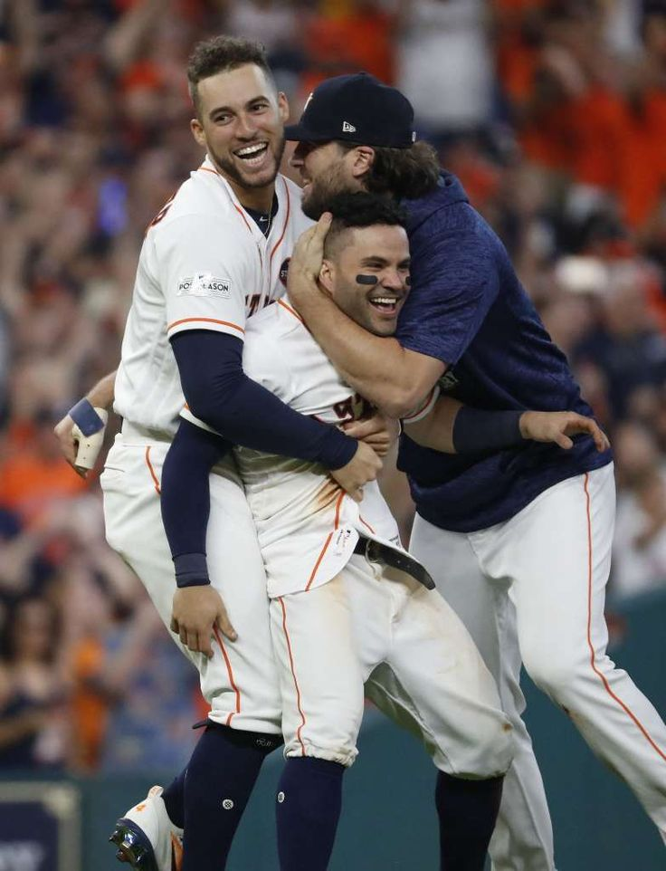 October 14, 2017:  ALCS Game 2: Yankees at Astros - Houston Astros Jose Altuve gets hugged by  George Springer and Jake Marisnik after Altuve scored the winning run on Carlos Correa's walk off double in the ninth inning of Game 2 of the ALCS at Minute Maid Park on Saturday, Oct. 14, 2017, in Houston. ( Karen Warren / Houston Chronicle ) Photo: Karen Warren/Houston Chronicle