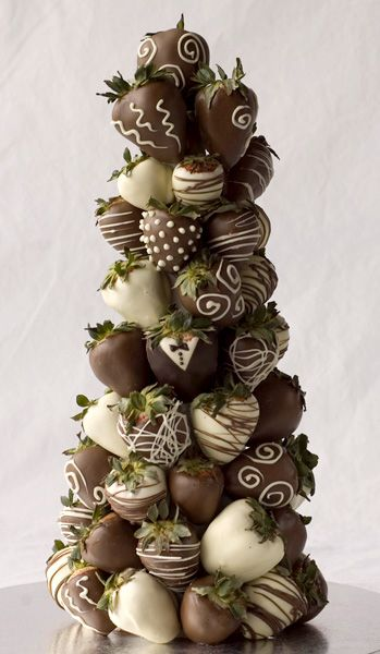 A fabulous looking tower of chocolate coated strawberries! Imagine this on a wedding dessert table! Via Amy Peterson Chocolates.