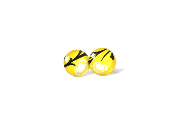 Yellow  Earrings with a floral design, $15.00