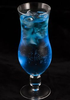 Blue Lagoon cocktail.Vodka based mixed drink.Serve Blue Lagoon Cocktail with lemon juice instead 7UP,if you wish.