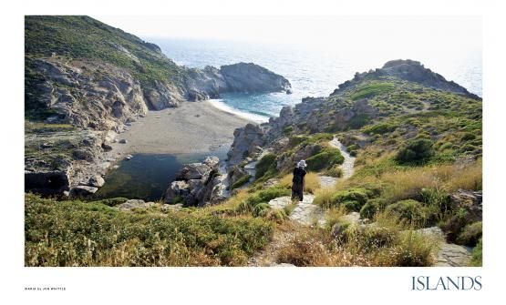 """ISLANDS recently named this European island of Ikaria in Greece to the ISLANDS Wish List: """"Live the Island Life Forever."""" This shot by ISLANDS photographer Jon Whittle shows an ancient cove on Ikaria that was once a port. If you look on the far left side, you'll see the corner of centuries-old ruins. History is everywhere here."""