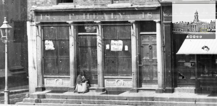 An exquisite Regency shopfront with fluted columns, window shutters and a granite 'platform' on Dublin's Arran Quay, photographed c.1870s