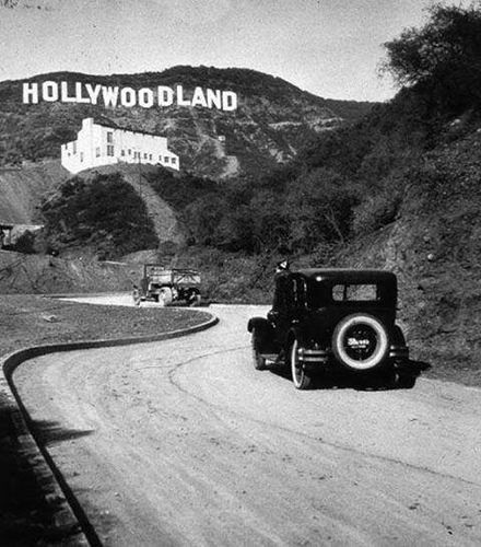 The famous Hollywood sign which originally said Hollywoodland . The last four letters were removed in 1949.