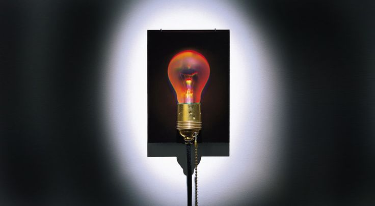 Wall lamp with hologram of a light bulb by Ingo Maurer. Genius!