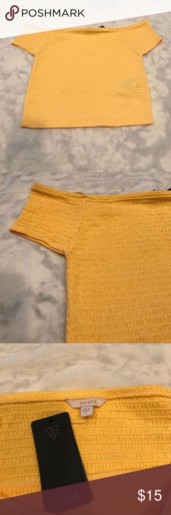 GUESS Smocked Off the Shoulder Crop Top Golden yellow off the shoulder crop smock top. Great summer piece, cool and easy breezy. Lots of stretch. 100% Rayon, exclusive of elastic. ☀️ Guess Tops Crop Tops