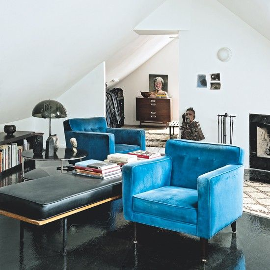 Mid-century style living room with blue armchairs