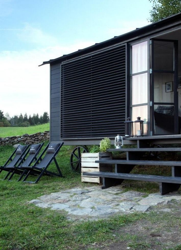 This is a modern version of a traditional wagon tiny house called the Maringotka designed by Miramari Design in Prague. It's a wonderful design that you can use to live simply in full-time bu…