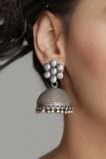 Beautiful Silver Jhumka Earrings With Intricate Carving & Flower Stud