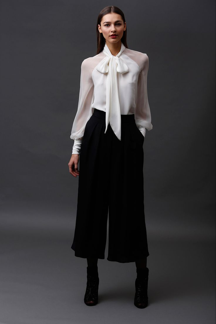 Shop this look on Lookastic:  https://lookastic.com/women/looks/white-long-sleeve-blouse-black-culottes-black-leather-ankle-boots/10988  — White Long Sleeve Blouse  — Black Culottes  — Black Cutout Leather Ankle Boots