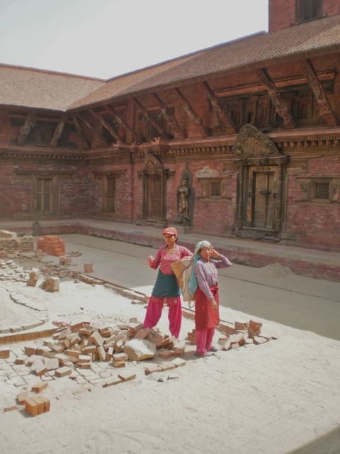 Two women laying bricks as part of the restoration of the Durbar Palace, Patan