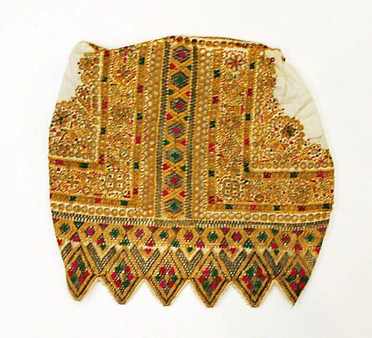 Wedding Ensemble.  Date: 1922. Culture: Slovak. Medium: cotton, silk, metal. Dimensions: Length at CB (a): 13 1/8 in. (33.3 cm). Length at CB (b): 15 1/2 in. (39.4 cm). Length (c): 33 in. (83.8 cm). Length (d): 32 3/4 in. (83.2 cm). Length (e): 8 7/8 in. (22.5 cm). Length (f–h): 122 1/4 in. (310.5 cm). Length (f–h): 38 1/2 in. (97.8 cm). Length (f–h): 30 5/8 in. (77.8 cm).