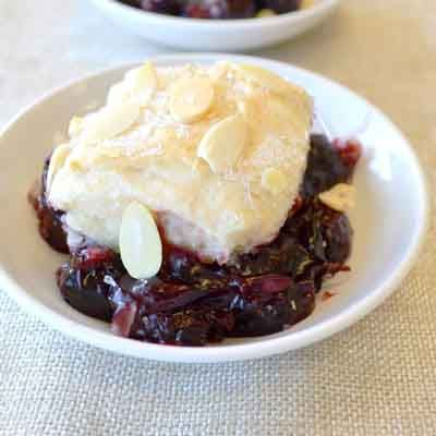 A classic cobbler made with frozen cherries and a sweet biscuit topping with a hint of almond.