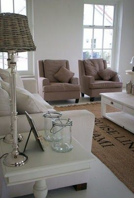 Love the cocoa chairs with the shades of white in this living room.