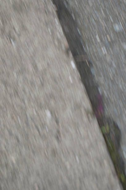 diagonal motion blur image of stony road and pavement surfaces
