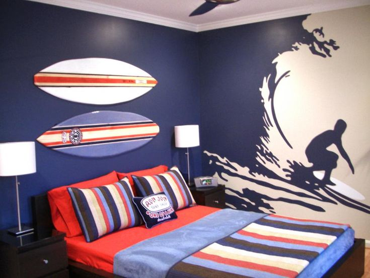 RMSer lizardshop got creative to give her son the beach-themed room he craved. Using an old-fashioned projector, she traced the surfer and wave design onto the wall then filled it in with latex paint. Custom-made to coordinate with the bedding, mini surfboards are the perfect accent.