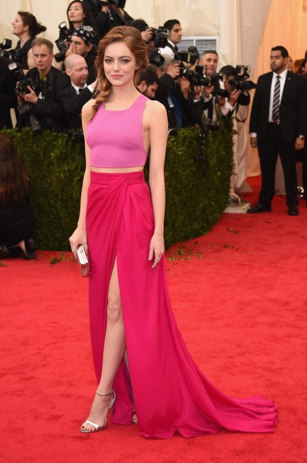 """Cov Editors Share Their Favorite Met Gala Looks of All Time: Best Colorblocking (Ever): Emma Stone, 2014     """"Is this Emma Stone or some sort of """"Laid-Back Barbie"""" come to life? While this colorblocked pink look is super simple—just a Thakoon crop top and slit skirt, made complete with a messy side-braid!—I think about it often...especially before I'm headed to a wedding, trying to tempt myself to rock a colorful set instead of a black dress.""""   coveteur.com"""