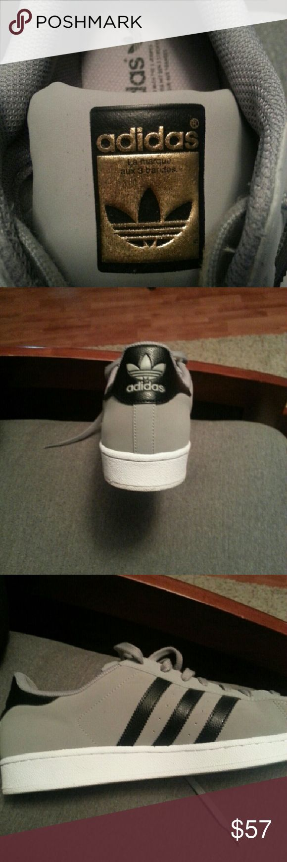 Limited Edition Stan Smith Adidas Shoes Men's size 13. Grey with black stripes and a gold adidas emblem on the tongue. Wore only 2 times. VERY NICE SHOES. MINT CONDITION!! Adidas Shoes Sneakers