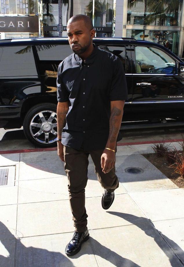 Kanye West wears Saint Laurent Signature Lace-Up Boots | UpscaleHype
