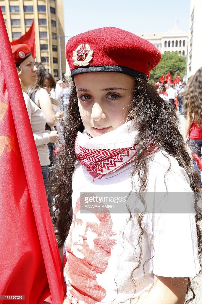 A young Lebanese girl wears a Che Guevara T-shirt and a beret with an insigna of the communist party during a march organised by the communist party to celebrate International Workers Day, also known as Labour Day, on May 1, 2015 in downtown Beirut.