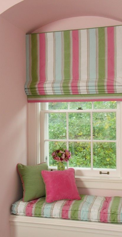Lovely pink and green Roman blind and matching window seat boxed cushion. Notice how the contrast at the bottom of the blind has used a section of the blind fabric turned on its side.