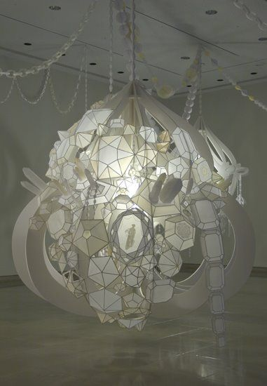 Here is a very interesting work of artist Kristen Hassenfeld. Chandeliers paper very complex and often monumental. Here is one commissioned by the Art Gallery at Rice University in Houston Texas.