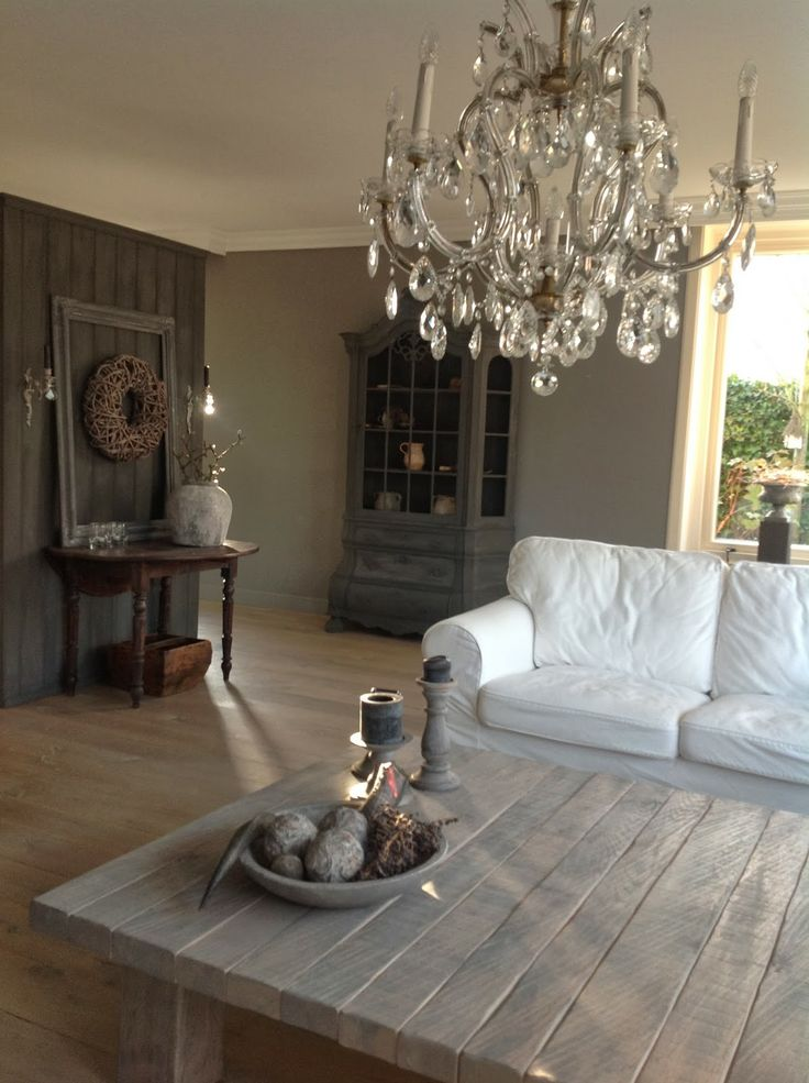 not sure on the chandelier but it seems to work. I like the oversized coffee table and elements of grey.
