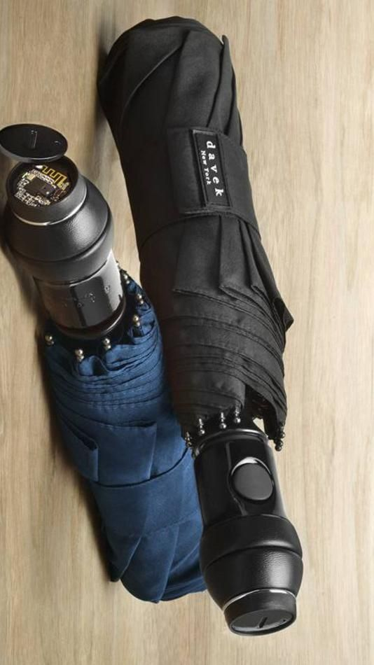 The Davek Alert Umbrella features a built-in Bluetooth proximity chip (hidden into the base) that alerts you if you've accidentally left without it.