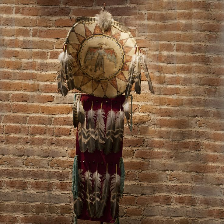This Warrior Shield is handcrafted and painted with the highest quality materials and utmost care by artist Russ Kruse. Each detail is crafted into the beading, painting and leather work and notably the stretched hide with painstaking care.