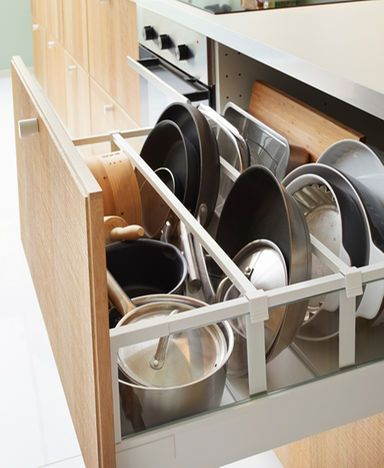Close-up of open IKEA kitchen drawer. Pots and pans stored neatly with dividers.