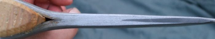 """This is a Petersen type """"K"""" axe. It has a wrought iron body with a carbon steel edge insert and an ash wood haft. The end on view shows the steel edge insert as a dark band against the light grey of the wrought iron. This effect can be highlighted by the use of acid, alternatively I can supply it with an abrasive finish which gives it a matt grey surface."""