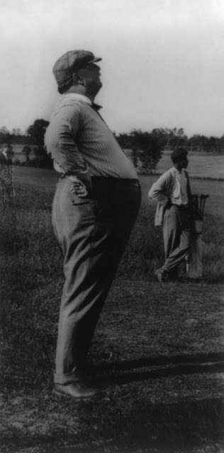 "President Taft was 6'4""  and weighed over 300 lbs while he was in office. Here he is on the golf course with his caddy."