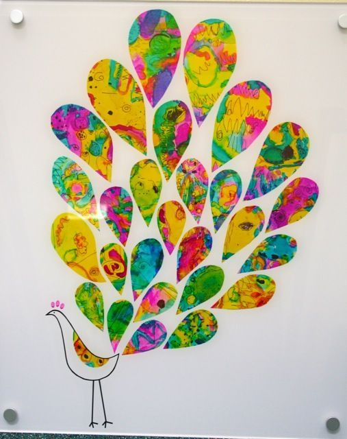 "Each kid could paint a large paper with bright colors then cut the ""feathers"" and create their own peacock"