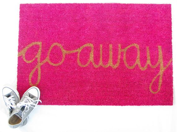 This welcoming pink door mat. | 18 Cute Gifts Every Homebody Will Appreciate