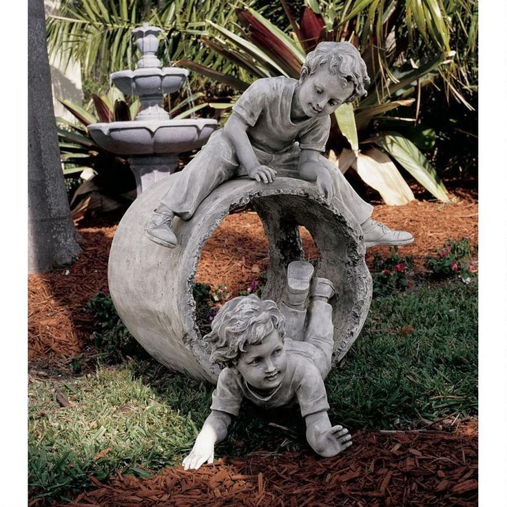 Delightful statue of two young boys playing hide and seek.