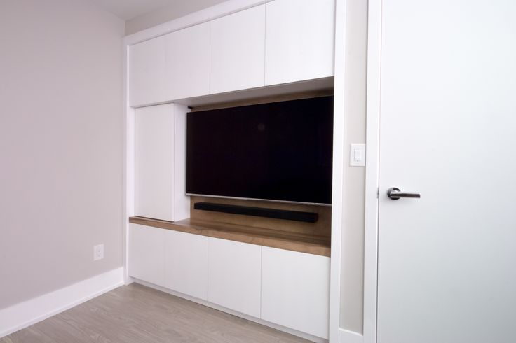 Turn your closet into a beautiful TV built-in with functional storage. Finished in a White high gloss lacquer with a Solid Maple shelf stained in Oakville Grey. Lets make it custom!!!
