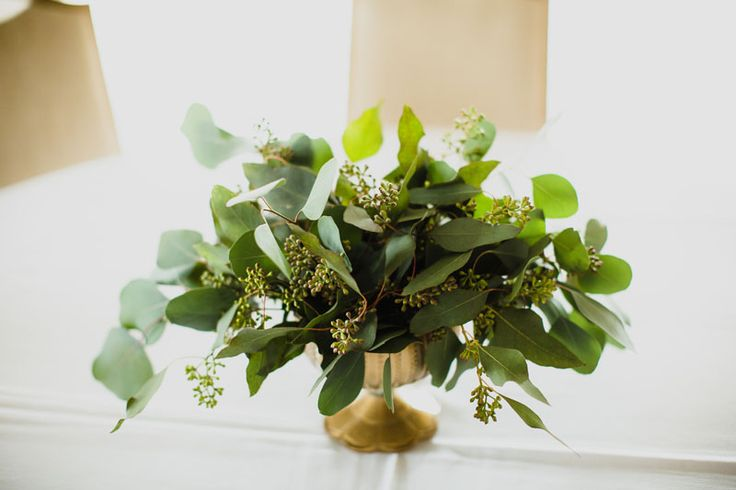 All foliage wedding centerpiece.  Seeded eucalyptus wedding centerpiece in gold compote vase by www.redpoppyfloral.com