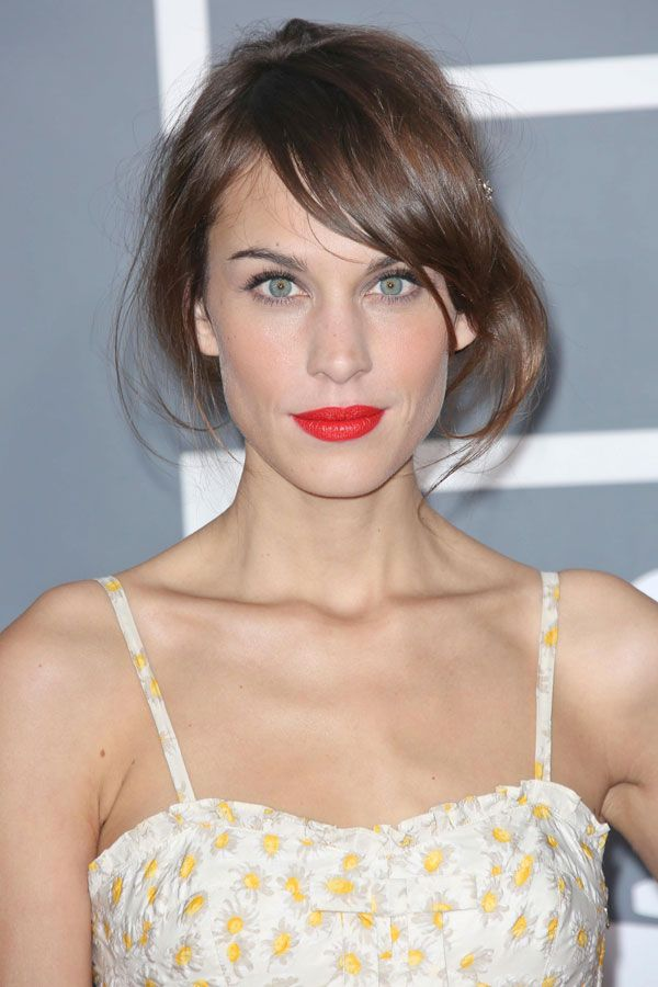 Alexa Chung's Vermillion Kisser. Although Alexa usually opts for low-key maquillage, this major lip moment totally fits with her elegant fashion ethos. It ties together her tousled waves, dewy complexion, and subtle smoky eye for sweet, summery look.