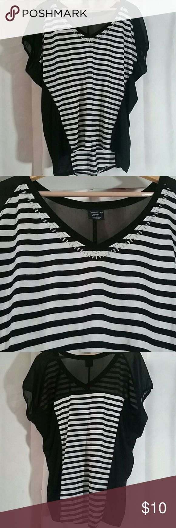 BLACK AND WHITE STRIPPED SHIRT BLACK AND WHITE STRIPPED SHIRT with silver studs around the neck area Faded Glory Tops Tees - Short Sleeve