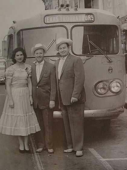 Kitty Wells with Johnny Wright and Jack Anglin in front of Ernest Tubb's Texas Troubadours tour bus.