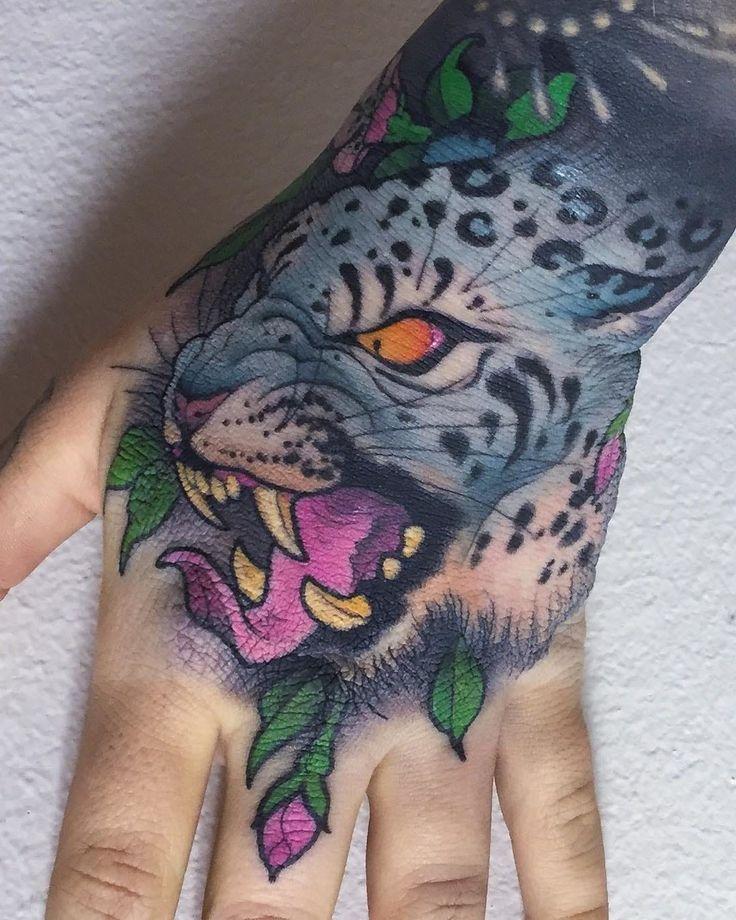 Leopard feline tattoo