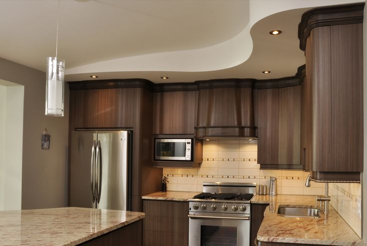 Cuisine en stratifier aux portes et moulures courbées. http://cuisinelucas.com/portfolio/beaudry-armoires-de-cuisine/gallery/cuisines/
