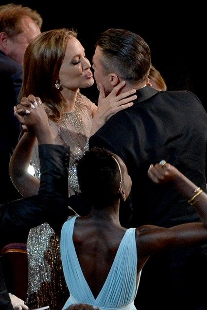 Angelina Jolie kisses partner Brad Pitt after his movie 12 Years A Slave wins Best Film.