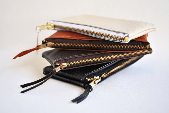 Small leather clutch bags handmade by SPIRITFIRE using sustainably sourced leather and finished with a durable brass zipper.