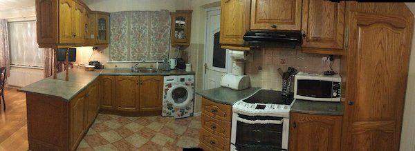 Full golden oak fitted kitchen. Including integrated  fridge, freezer, electric cooker as new