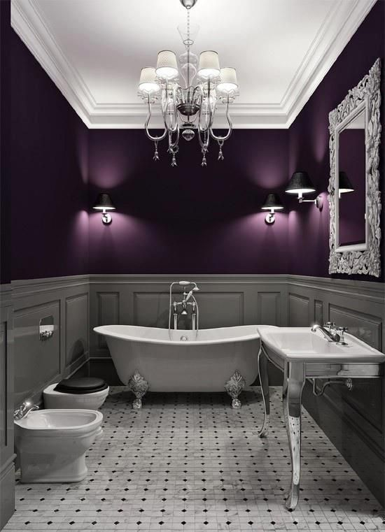 old fashioned tile floor with free standing white tub and vaulted ceiling and chandelier