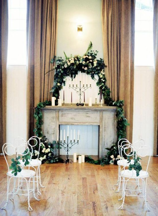 Faux Fireplace Wedding Backdrop With Candles Plus Greenery And