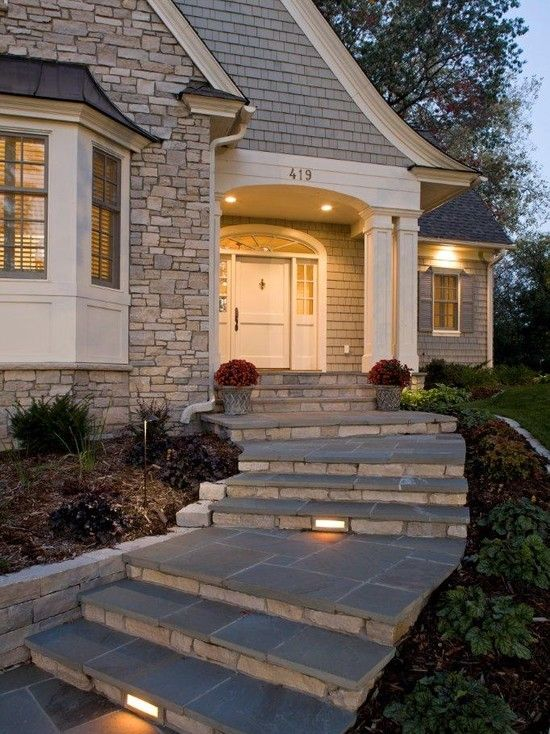 Sidewalk with blue stone tile slabs river rock risers and for Exterior stone stairs design