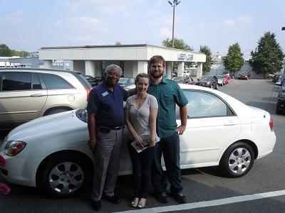 Folger Subaru Sales Consultant Bill Barber with Mr. & Mrs. Petersen and their 2006 Kia Spectra sedan!